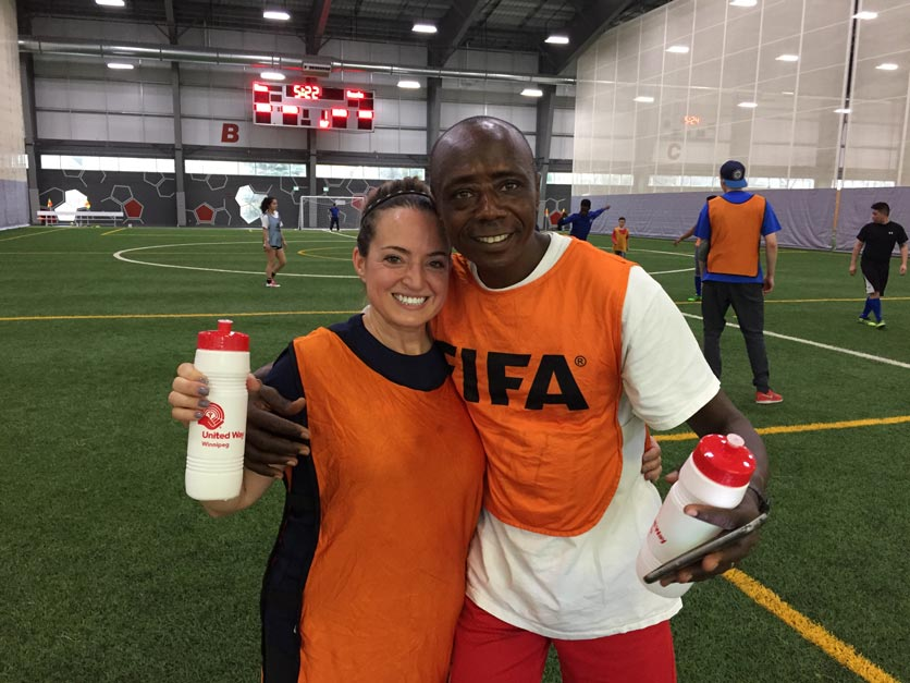 CWB National Leasing employees welcome newcomers in need with a friendly game of soccer