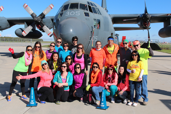 The National Leasing team at the United Way Winnipeg Plane Pull event, decked out in their tight, florescent-coloured costumes..