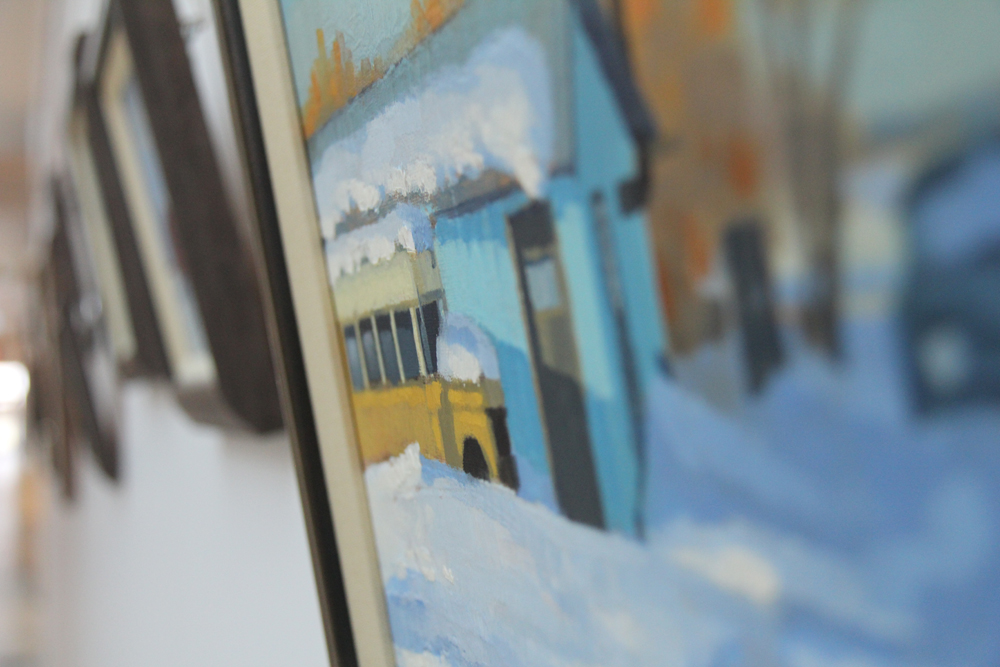 A painting of a winter scene hanging at CWB National Leasing head office