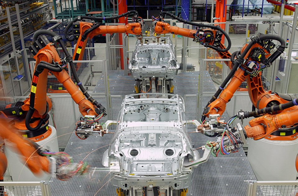 A photo of automated manufacturing equipment building cars