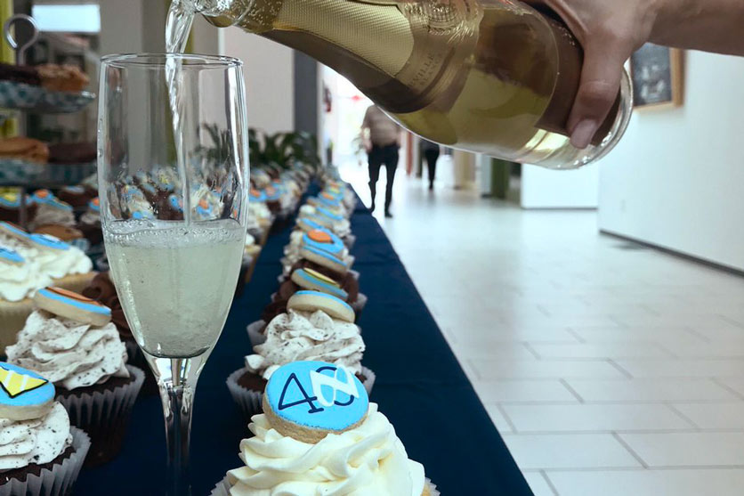 National Leasing employees celebrate the company's 40th birthday with a 300-person champagne toast