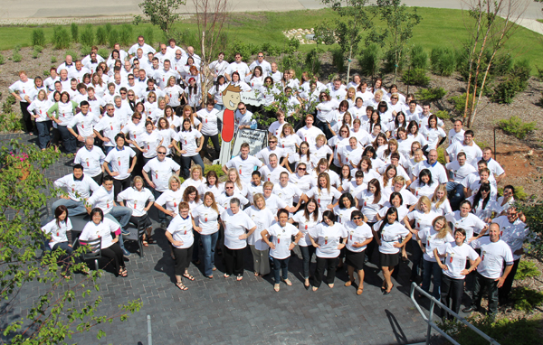 National Leasing employees gather for a sunny group photo in 2012