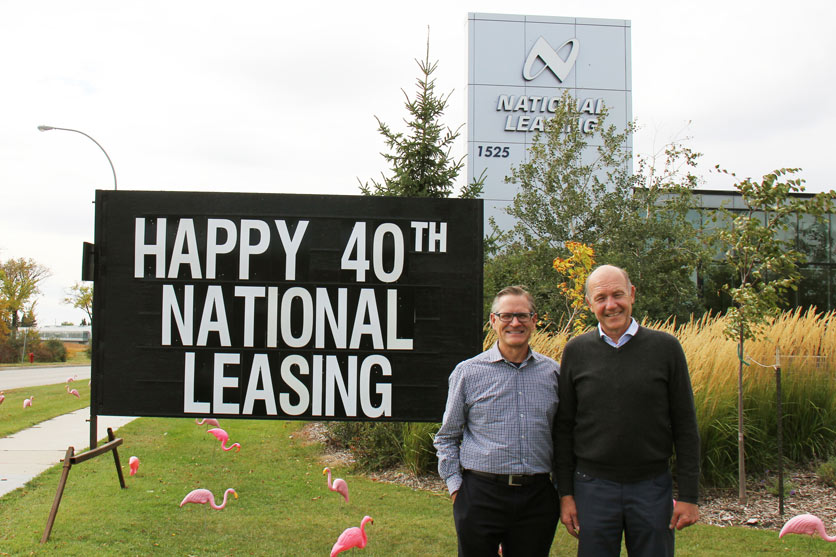 Michael Dubowec (left) with Tom Pundyk celebrating CWB National Leasing's 40th year in business.