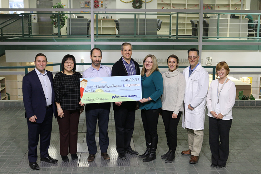 CWB National Leasing employees visit the Albrechtsen Research Centre to see the impact of CWB National Leasing's $15,000 donation.