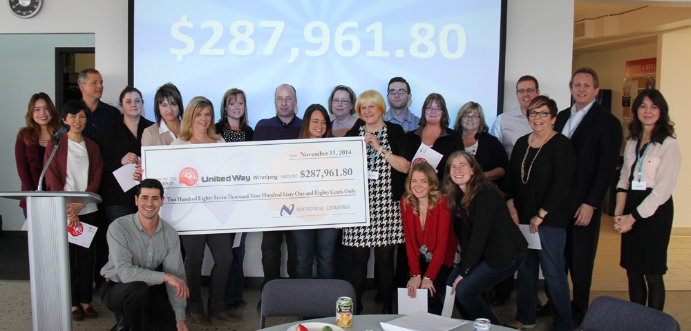 National Leasing United Way Committee presents cheque for $287,961 to United Way representatives