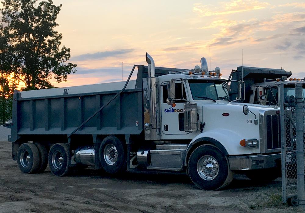 A photo of the Peterbilt dump truck that SheaRock Construction Group leased with CWB National Leasing