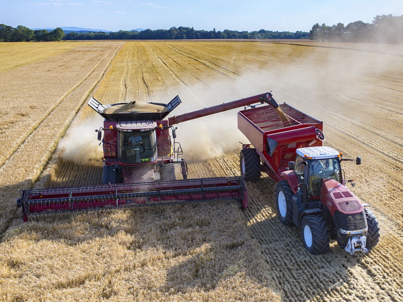 A combine harversting a farmer's field